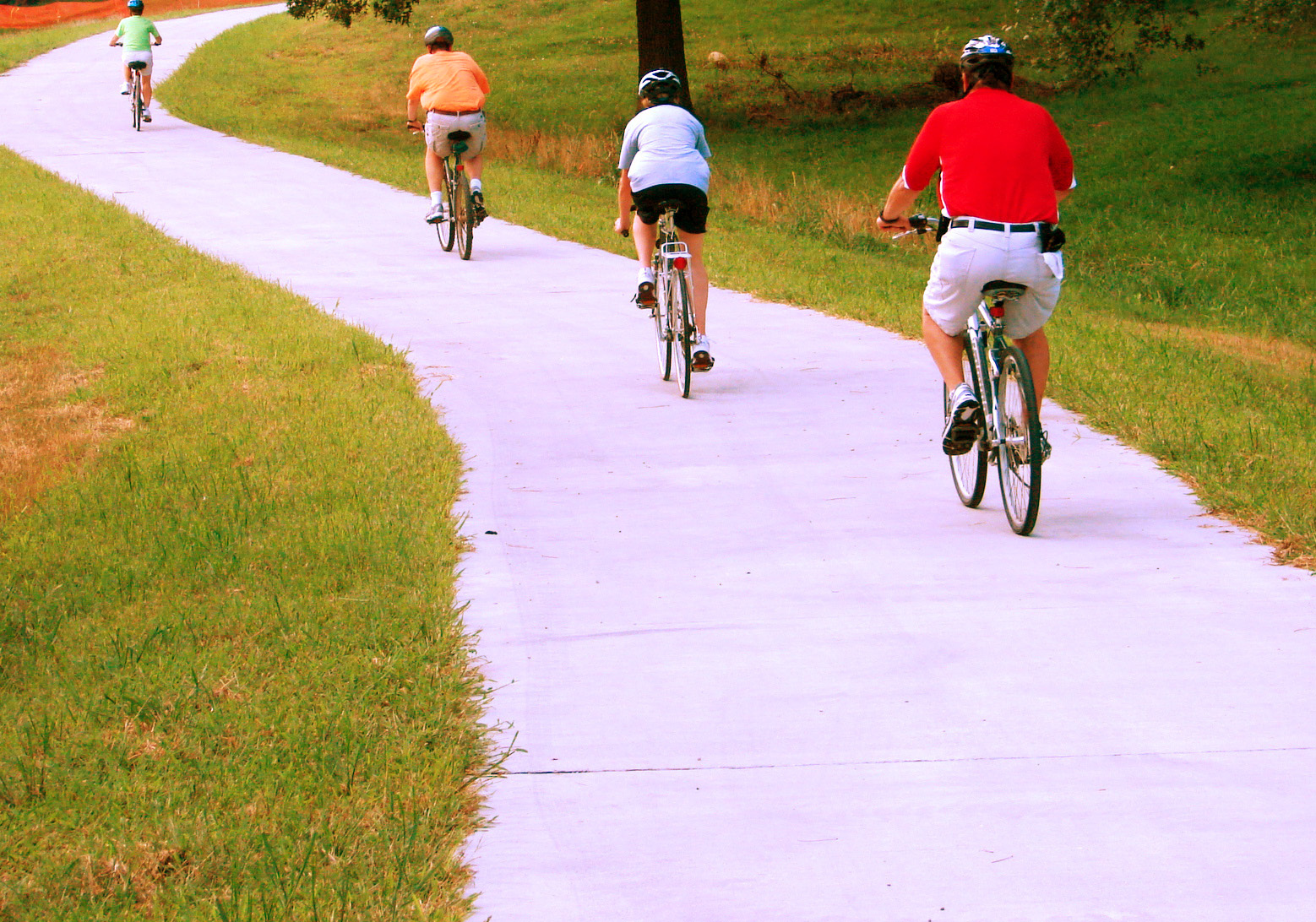 Four bicyclists head up the hill on the Jerry Kelley Trail