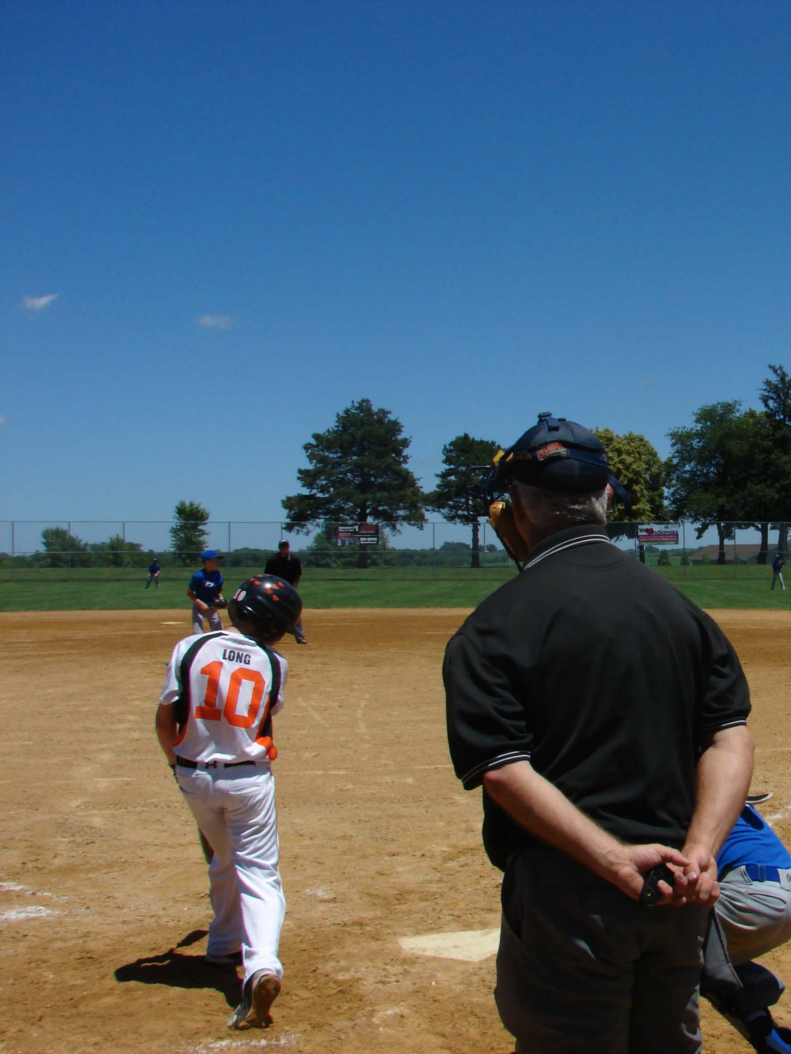 Umpire watches as boy swings during a game at Pickard Park Sports Complex