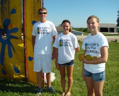 Members stand in front of dunk tank for Indianola